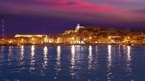 Ibiza Eivissa town sunset with city lights reflection in Mediterranean sea of balearic Islands stock video