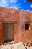 Ibiza grunge orange facade in Benirras beach Stock Photos
