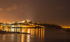 Ibiza island night view of Eivissa town and sea lights reflectio Royalty Free Stock Photography