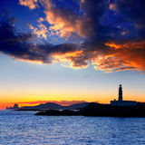 Ibiza island sunset Freus lighthouse and Es Vedra Royalty Free Stock Image