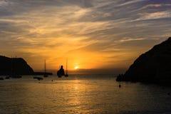 Ibiza island sunset sihouettes. Quiet scene: Sailboats in a harbor at sunset. Mediterranean sea of Ibiza island Royalty Free Stock Image