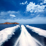 Ibiza Sa Conillera island from boat wake San Antonio Royalty Free Stock Images