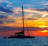 Ibiza san Antonio Abad catamaran sailboat sunset Stock Photography