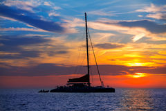 Ibiza san Antonio Abad catamaran sailboat sunset Stock Photos