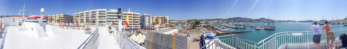 IBIZA, SPAIN - JUNE 2015: Tourists walk in the city port, panora. Mic view. Ibiza is a famous tourist destination in Spain Stock Photos