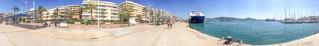 IBIZA, SPAIN - JUNE 2015: Tourists walk in the city port, panora. Mic view. Ibiza is a famous tourist destination in Spain Royalty Free Stock Image