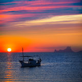 Ibiza sunset Es Vedra view and fisherboat formentera stock photography