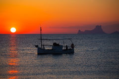 Ibiza sunset Es Vedra view and fisherboat formentera Stock Image