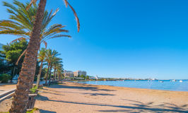 Ibiza sunshine on the waterfront in Sant Antoni de Portmany,  Walk along beach or main boardwalk. Stock Photography