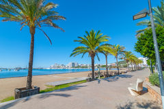 Ibiza sunshine on the waterfront in Sant Antoni de Portmany,  Walk along beach or main boardwalk. Royalty Free Stock Image