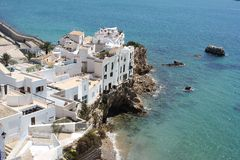 Ibiza town peninsular into sea. Ibiza town white buildings in sunshine jutting into blue sea Stock Photography