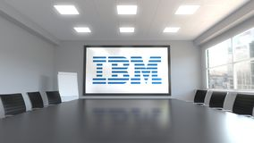 IBM logo on the screen in a meeting room. Editorial 3D rendering. IBM logo on the screen in a meeting room. Editorial 3D Royalty Free Stock Photo