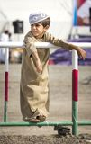 Omani kid at a races. Ibri, Oman, 28th April 2018: omani kid in traditional outfit  at the races Stock Image