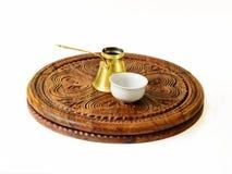 Ibrik, Turkish coffee pot, and a fildzan, Turkish coffee cup. Ibrik Turkish coffee pot and a fildzan Turkish coffee cup on a beautiful carved wooden salver royalty free stock photo