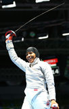 Ibtihaj Muhammad of the United States celebrates victory in the Women`s individual sabre match of the Rio 2016 Olympic Games. RIO DE JANEIRO, BRAZIL - AUGUST 8 Stock Image