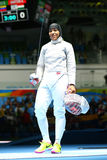 Ibtihaj Muhammad of the United States celebrates victory in the Women`s individual sabre of the Rio 2016 Olympic Games. RIO DE JANEIRO, BRAZIL - AUGUST 8, 2016 Stock Image