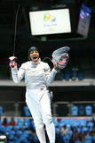 Ibtihaj Muhammad of the United States celebrates victory in the Women`s individual sabre of the Rio 2016 Olympic Games. RIO DE JANEIRO, BRAZIL - AUGUST 8, 2016 Stock Photos