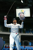 Ibtihaj Muhammad of the United States celebrates victory in the Women`s individual sabre of the Rio 2016 Olympic Games. RIO DE JANEIRO, BRAZIL - AUGUST 8, 2016 Stock Photo