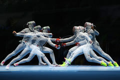 Ibtihaj Muhammad of United States R and Sofya Velikaya of Russia compete in the Women`s Sabre Team of the Rio 2016 Olympic Games Stock Image