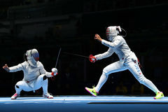 Ibtihaj Muhammad of United States R and Sofya Velikaya of Russia compete in the Women`s Sabre Team of the Rio 2016 Olympic Games Stock Images