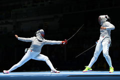 Ibtihaj Muhammad of United States R and Sofya Velikaya of Russia compete in the Women`s Sabre Team of the Rio 2016 Olympic Games Stock Photos