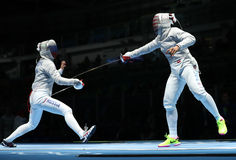Ibtihaj Muhammad of United States R and Sofya Velikaya of Russia compete in the Women`s Sabre Team of the Rio 2016 Olympic Games Royalty Free Stock Image