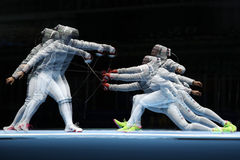 Ibtihaj Muhammad of United States R and Sofya Velikaya of Russia compete in the Women`s Sabre Team of the Rio 2016 Olympic Games Stock Photography