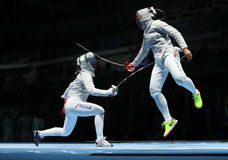 Ibtihaj Muhammad of United States R and Sofya Velikaya of Russia compete in the Women`s Sabre Team of the Rio 2016 Olympic Games Stock Photo