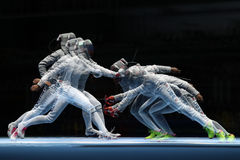 Ibtihaj Muhammad of United States R and Sofya Velikaya of Russia compete in the Women`s Sabre Team of the Rio 2016 Olympic Games Royalty Free Stock Photos