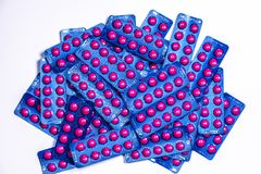 Ibuprofen in pink tablet pills pack in blue blister pack on white background with copy space. Ibuprofen for relief pain. Headache, high fever and anti stock photo