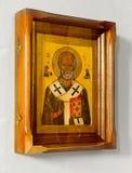 Icône chrétienne en bois sur le fond blanc image stock