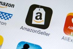 Icône d'application de vendeur d'Amazone sur le plan rapproché d'écran de l'iPhone X d'Apple Icône de Google AmazonSeller APP App Photo stock