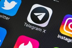 Icône d'application du télégramme X sur le plan rapproché d'écran de l'iPhone X d'Apple Icône du télégramme X APP Le télégramme X Photographie stock libre de droits