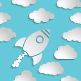 Icône de fusée blanche avec des nuages sur un fond d'air bleu - Photo stock
