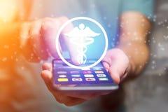 Icône de pharmacie sortant une interface de smartphone - technologie concentrée photo libre de droits