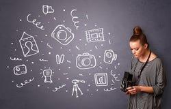 Icônes de photographie de tir de fille de photographe illustration libre de droits