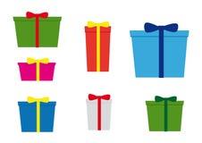 Icônes de simplicité, ensemble de sept cadeaux de Noël avec de diverses couleurs et arc illustration stock