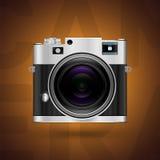 Icône classique d'appareil-photo sur le fond brun Image libre de droits