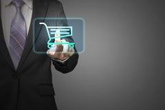 Icône de caddie de contact d'homme d'affaires pour acheter sur la ligne dans g Photographie stock libre de droits