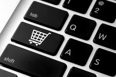 Icône de commerce électronique d'affaires sur le bouton de clavier d'ordinateur Photographie stock