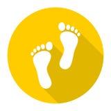 Icône de deux empreintes de pas avec la longue ombre Photo stock
