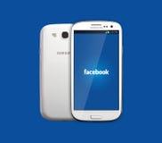 Icône de Facebook sur le smartphone Photographie stock