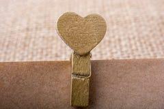 Icône de forme de coeur attachée à la pince à linge Image libre de droits