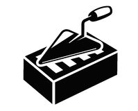 Icône de truelle et de brique Image stock