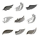 Icônes abstraites d'ailes d'ange ou d'oiseau de plume réglées Photographie stock