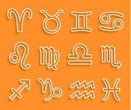 Icônes blanches brillantes de zodiaque sur le fond orange Photo stock
