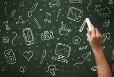 Icônes d'écriture de main sur le tableau noir Photos libres de droits