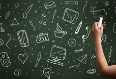 Icônes d'écriture de main sur le tableau noir Images libres de droits