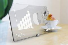 Icônes d'affaires sur le comprimé avec l'écran tactile en verre Photo stock