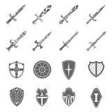 Icônes d'emblèmes d'épées de bouclier réglées Photos stock